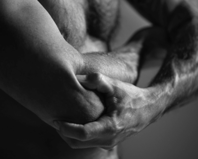 Man applying presssure on arm