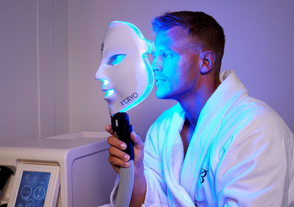 Treatment_Cryo-Facial_Man-placing-Cryo-mask