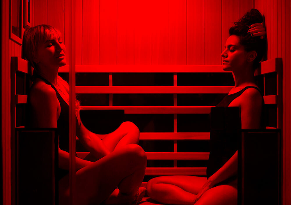 Treatment_LED-Infrared-Sauna_Two-woman-sitting-in-sauna-relaxed