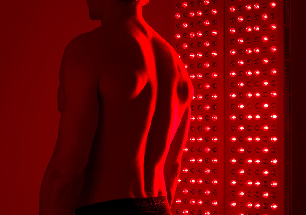 Treatments_LED-light-therapy-body_Man-stands-infront-of-light