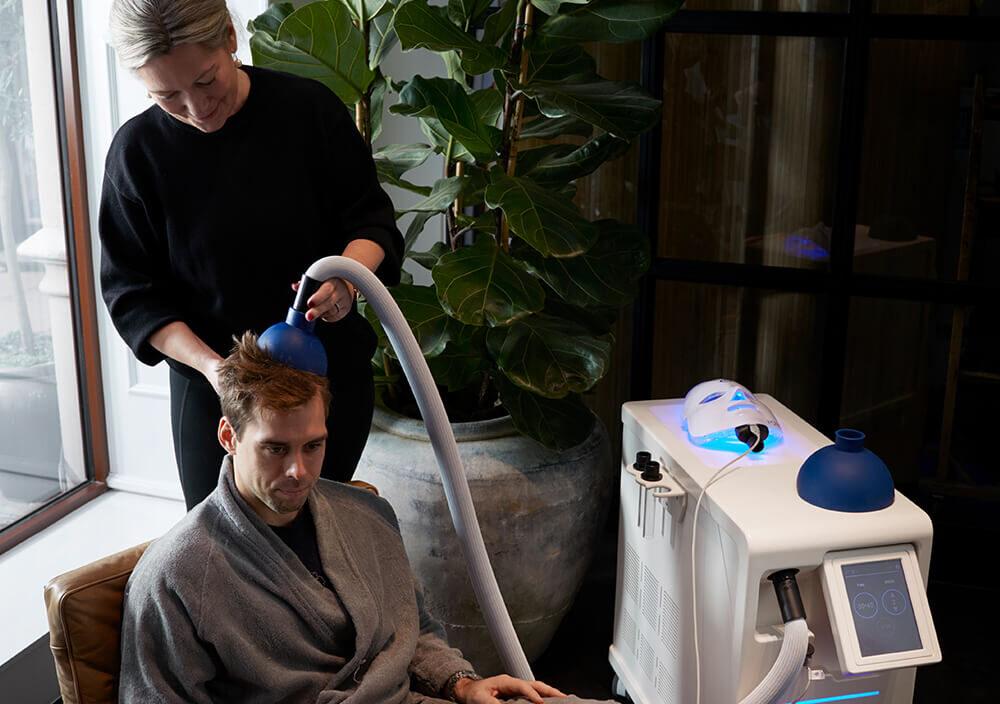 Treatments_Localised-cryo_Man-getting-cryo-on-top-of-head