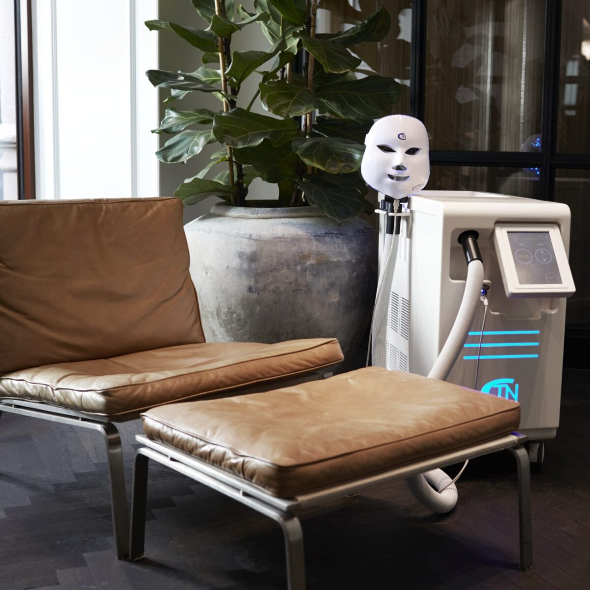 Cryo Face mask and machine close to a brown chair at One Thirty Labs studio